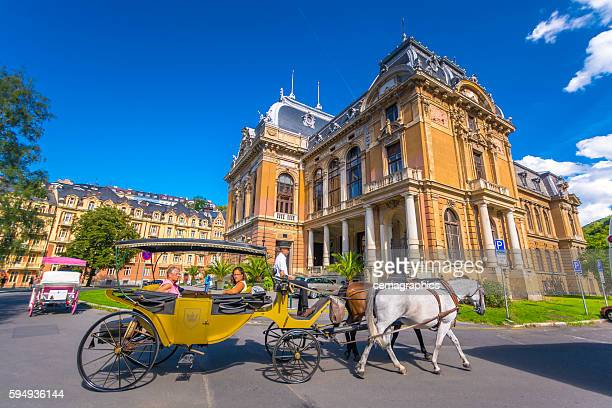 View of phaeton with historic building at Karlovy Vary
