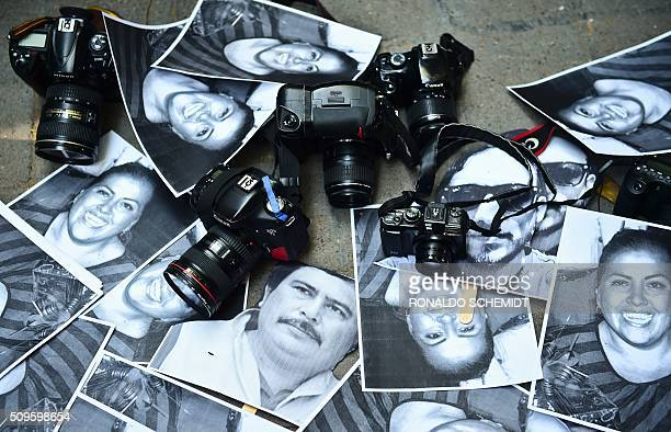View of photos of killed journalists and cameras outside the Veracruz state representation office during a journalists protest in Mexico City on...
