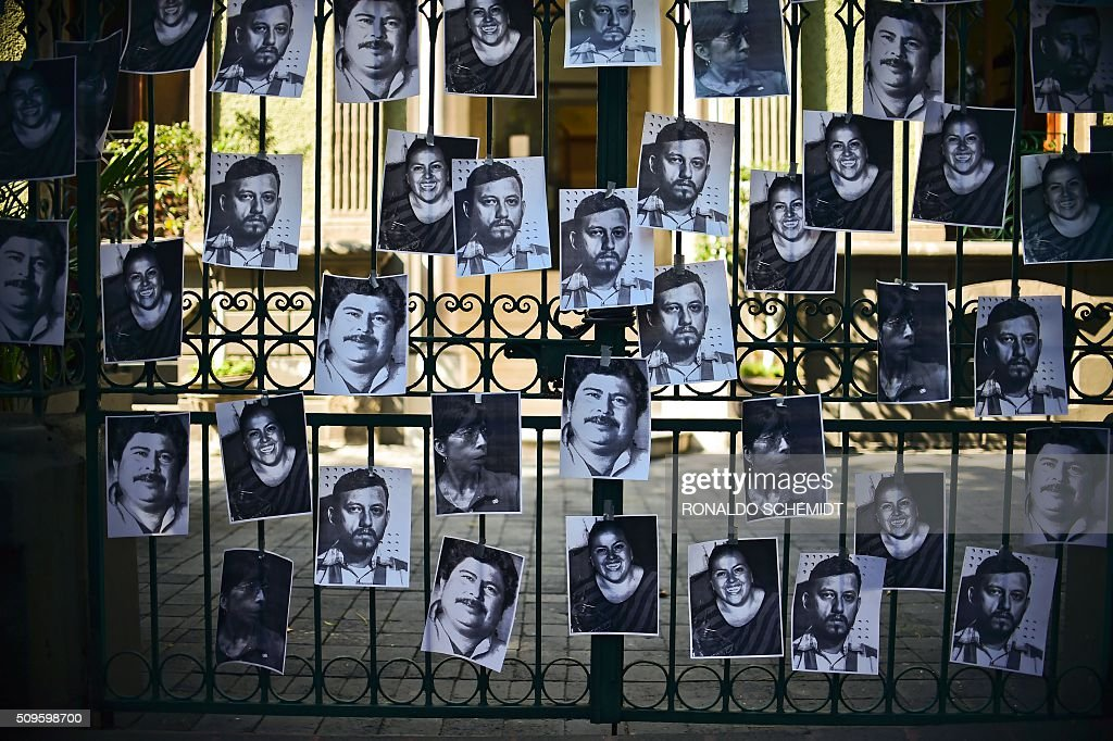 View of photos of killed journalists stuck on the fence of the Veracruz state representation office during a journalists protest in Mexico City on February 11, 2016. Mexican journalist Anabel Flores Salazar's funeral took place Wednesday after she was found killed at a road after being kidnapped Monday in Veracruz state, one of the most dangerous for journalists. AFP PHOTO/RONALDO SCHEMIDT / AFP / RONALDO SCHEMIDT