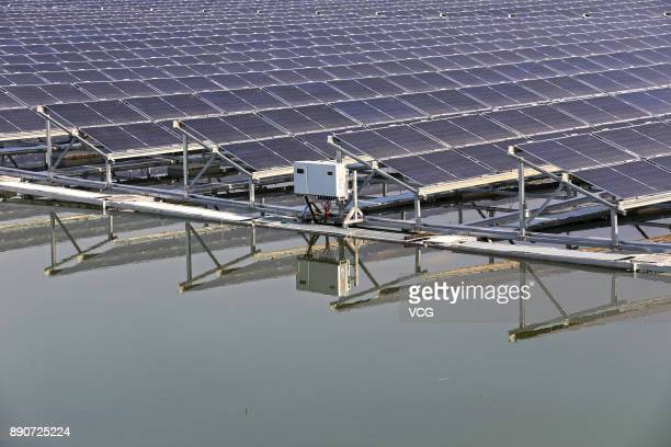 A view of photovoltaic plant above a pond at the mining subsidence area in Liuqiao Town on December 11 2017 in Huaibei Anhui Province of China The...