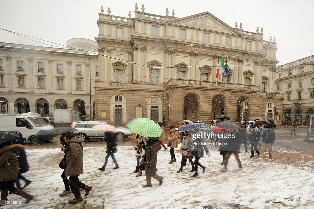 A view of Piazza Scala covered with snow on February 11, 2013 in Milan, Italy.Wind, snow and tempetarture under zero over the country has affected regions from North Italy to South Italy, transports has been affected with train cancellations and road closures.