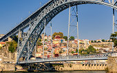 View of colorful city of Porto in Portugal and landmark Luis I bridge over Douro river