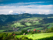 View of Pieniny and High Tatras from Gorce mountains. Village Tylka.