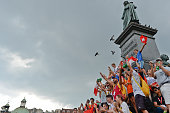 A view of pilgrims at the Adam Mickiewicz monument in Krakow main square ahead of the official opening Mass and the World Youth Day 2016 in Blonia...