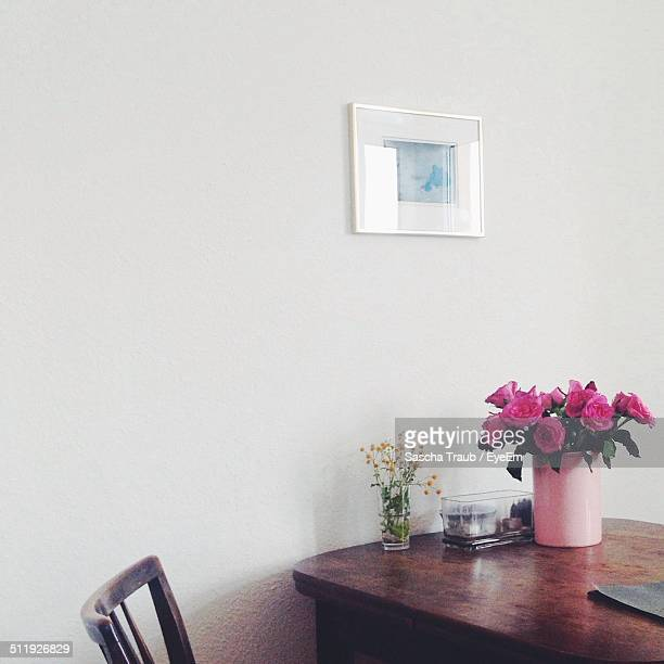 View of pink roses on table in living room