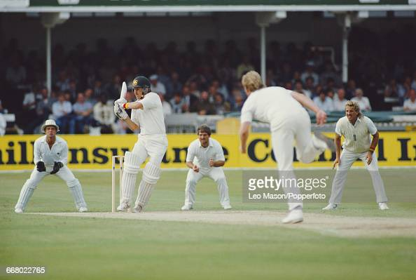 View of play between England and Australia with Graeme Wood of Australia batting Paul Allott of England bowling Mike Gatting and Ian Botham in slip...