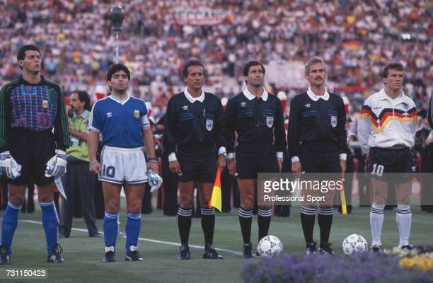 View of players and captains of the Argentina and West Germany teams pictured lined up together with match officials prior to the start of the 1990...