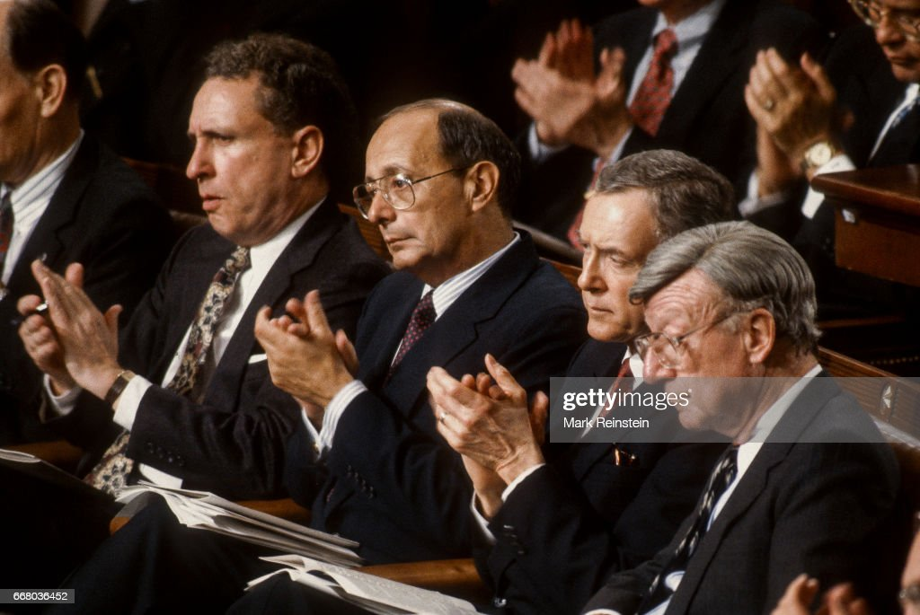 View of politicians as they applaud during President George HW Bush's State of the Union address before a joint session of Congress, Washington DC, January 28, 1992. Among those pictured are, from left, Senators Arlan Spector (1930 - 2012), Al D'Amato, Orrin Hatch, and William V Roth Jr (1921 - 2003).
