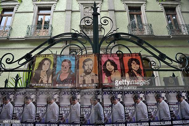 View of posters with the image of Veracruz state governor Javier Duarte reading 'State without law' outside the representative office of the Veracruz...
