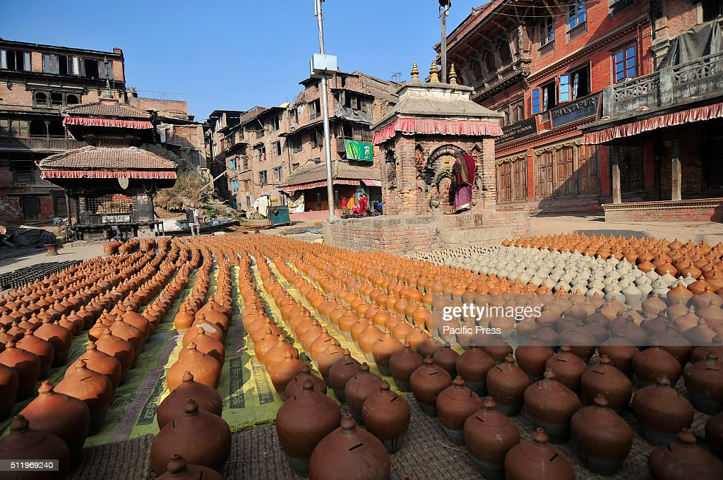 BHAKTAPUR NEPAL KATHMANDU NP NEPAL View of pots dried at Pottery Square in Bhaktapur where small scale traditional pottery making industry are found...
