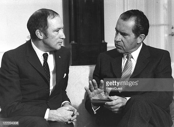 View of President Richard Nixon speaking with Canadian Prime Minister Pierre Trudeau during a visit to the White House March 1969