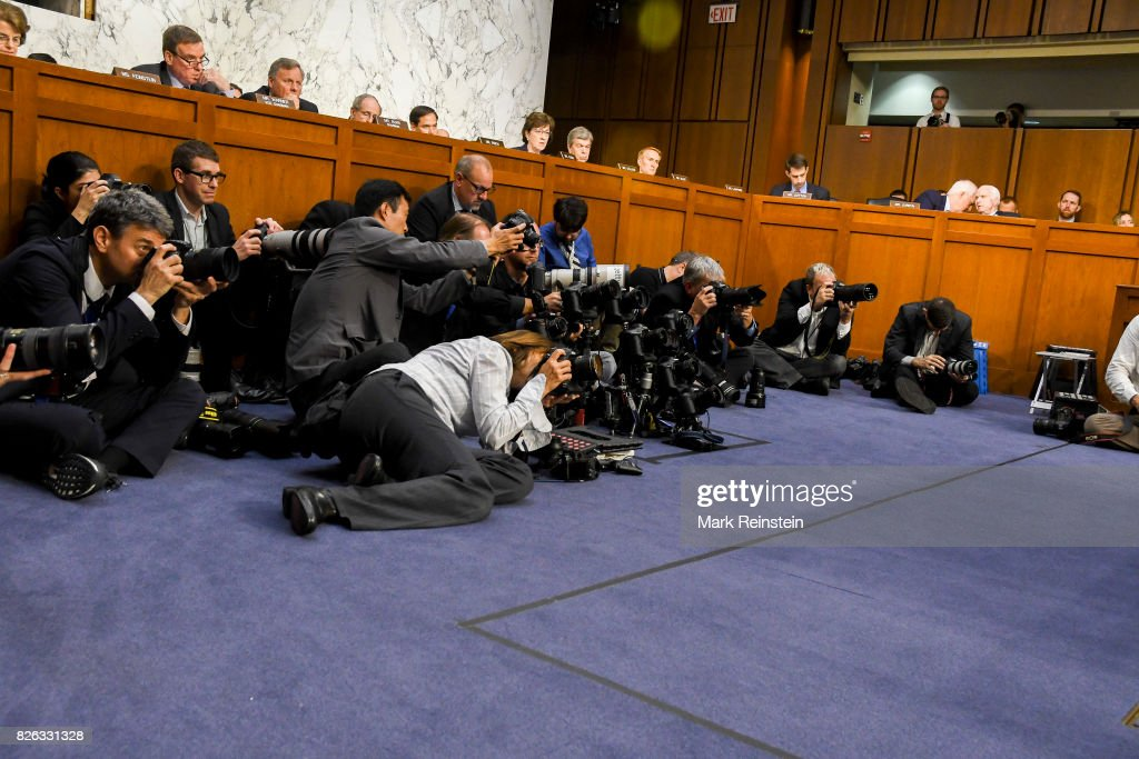 View of press photographers arranged beneath the desks of the US Senate Intelligence Committee , Washington DC, June 13, 2017. They were there for testimony by US Attorney General Jeff Sessions. The pictured Senators are, from extreme left, Dianne Feinstein, Mark Warner, Richard Burr, James Risch, Marco Rubio, Susan Collins, Roy Blunt, James Lankford, Tom Cotton, John Cornyn, and John McCain.