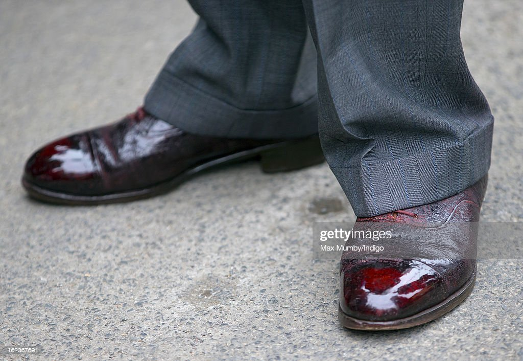 A view of <a gi-track='captionPersonalityLinkClicked' href=/galleries/search?phrase=Prince+Charles&family=editorial&specificpeople=160180 ng-click='$event.stopPropagation()'>Prince Charles</a>, Prince of Wales's shoes seen as he visits Uley Community Stores and Post Office on February 22, 2013 in Uley, Gloucestershire, England.
