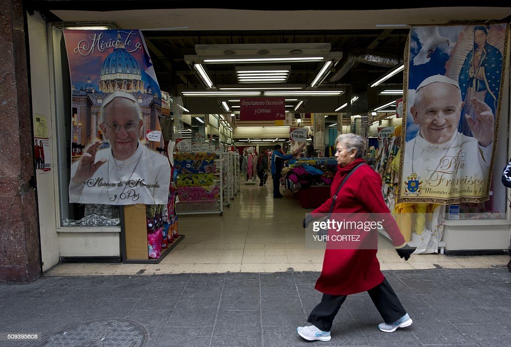 View of printed cloth displaying an image of Pope Francis and the Virgin of Guadalupe in Mexico City on February 10, 2016. Pope Francis will visit four Mexican states from next February 12 to 17. AFP PHOTO / YURI CORTEZ / AFP / YURI CORTEZ