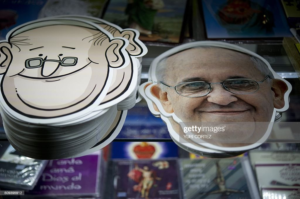 View of printed masks of Pope Francis for sale at a store in Mexico City on February 10, 2016. Pope Francis will visit four Mexican states from next February 12 to 17. AFP PHOTO / YURI CORTEZ / AFP / YURI CORTEZ