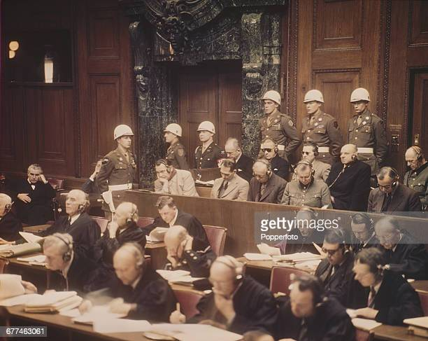 View of proceedings at the first Nuremberg trial with Nazi leaders pictured sitting in the dock before the International Military Tribunal at the...