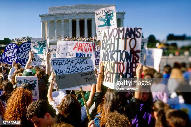 View of prochoice demonstrators many with signs during the Mobilize for Women's Lives Rally at the Lincoln Memorial on the National Mall Washington...