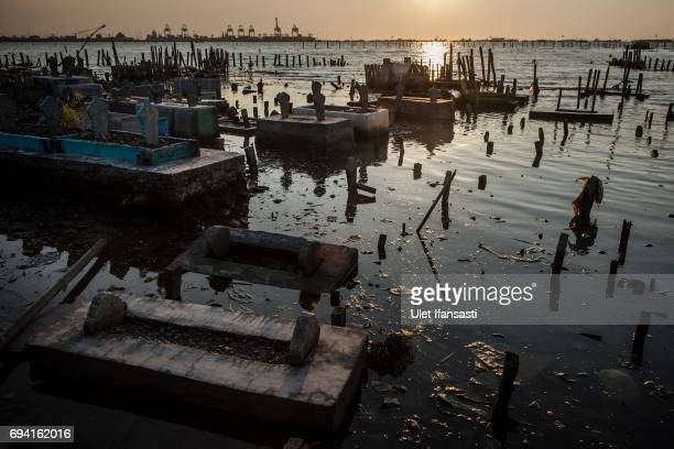 A view of public cemetery which submerged by flood waters from rising sea levels on June 8 2017 in Semarang Indonesia Indonesia is known to be one of...