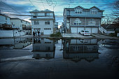 A view of puddle on a street of Staten Island that experienced severe damage and loss of life along with the destruction of many buildings during...