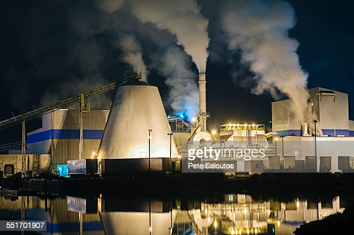 View of pulp mill and smokestacks on waterfront at night, Strait of Juan de Fuca, Port Angeles, Washington State, USA