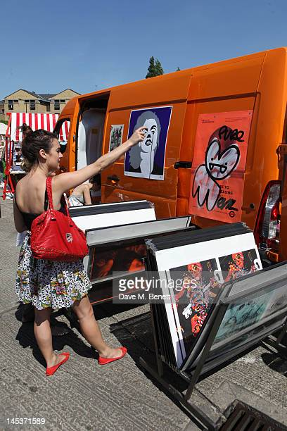 A view of Pure Evil's stall at the 2012 Vauxhall Art Car Boot Fair at the Old Truman Brewery Brick Lane on May 27 2012 in London England
