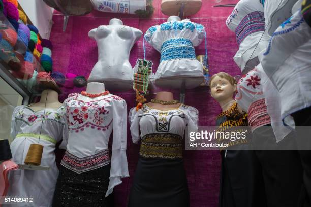 View of Puruhastyle handembroidered outfits by Ecuadorean fashion designer Lucia Guillin at her workshop in Riobamba Ecuador on June 30 2017 The...