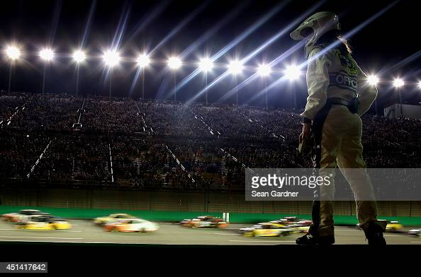 A view of race action from pit road during the NASCAR Sprint Cup Series Quaker State 400 presented by Advance Auto Parts at Kentucky Speedway on June...
