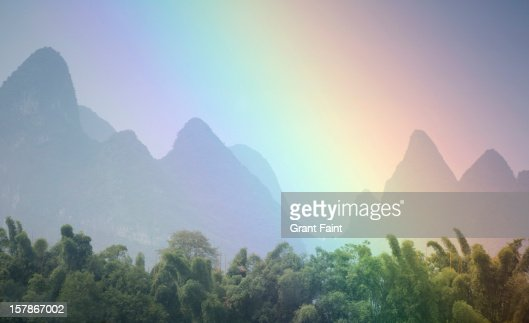 View of rainbow by mountains.