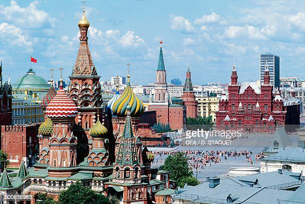 View of Red Square with St Basil's cathedral in the foreground and the State historical museum in the background Moscow Russia