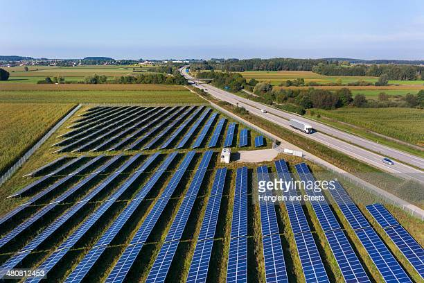 View of road and solar power panels, Munich, Bavaria, Germany