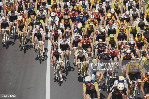 View of road race cyclists grouped in the peleton during competition by teams in the 1990 Tour de France in France in July 1990 The 1990 Tour would...