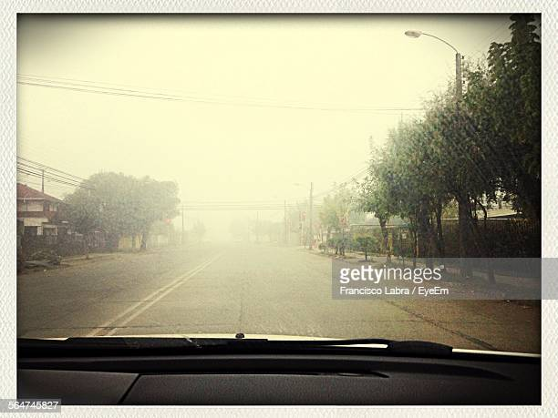 View Of Road Seen Through Car Windshield