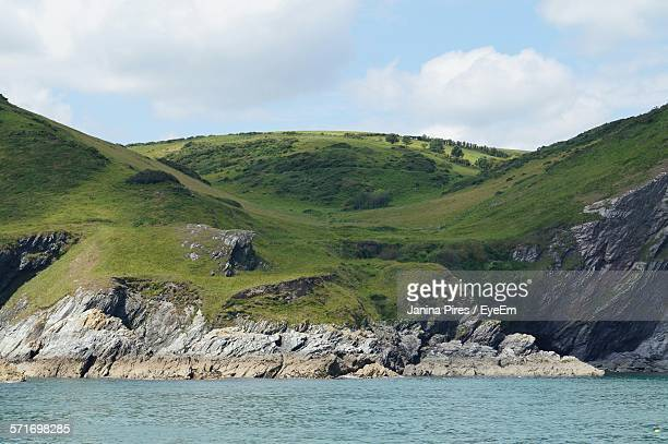 View Of Rocky Coastline From Sea