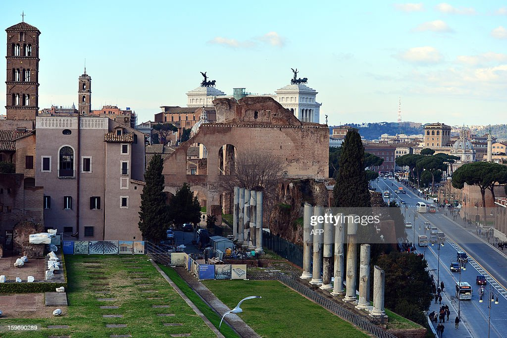 A view of Rome from the Colosseum on January 18, 2013 in Rome. Traces of decorations in blue, red and greenwere found in a corridor currently closed to the public while archaeologists were working to restore an area between the second and third floor of the Colosseum, which has fallen into disrepair in recent years. AFP PHOTO / GABRIEL BOUYS