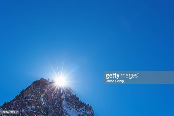 View of rugged mountain peak, sunlight and blue sky, Mont Blanc massif, Graian Alps, France
