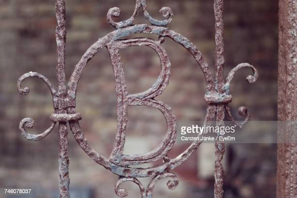 View Of Rusty Gate With Letter B