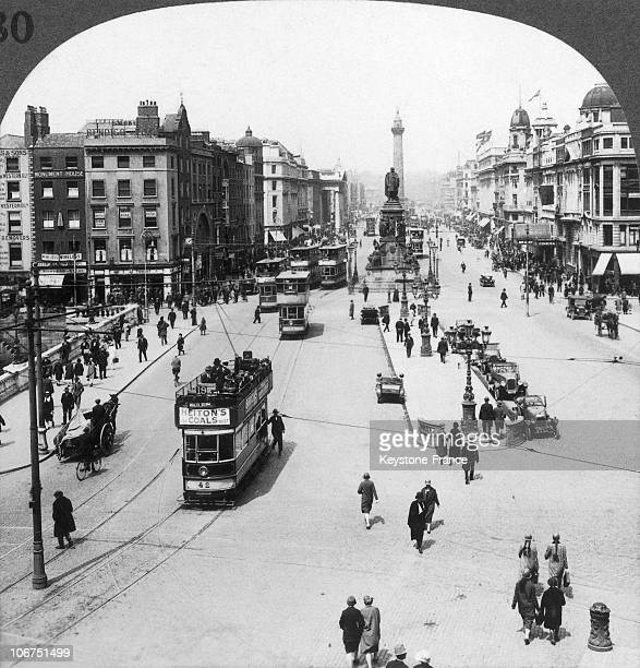 View Of Sackville Street In Dublin With Pedestrians DoubleDecker Trams The O'Connell Monument And The Nelson Column Around 19001920