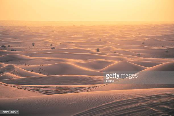 View of sand dunes at sunset