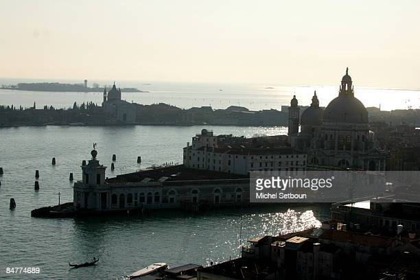 A view of Santa Maria della Salute church at the entrance of the Grand Canal and Giudecca Canal in the backgroud Guidcca island and the Redentore...