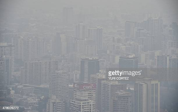 View of Santiago covered by smog on June 21 2015 Stations located in the west of the city as Pudahuel and Cerro Navia presented critical levels of...
