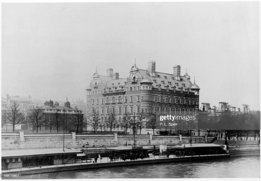 A view of Scotland Yard from across the Thames River in London England Circa 1900