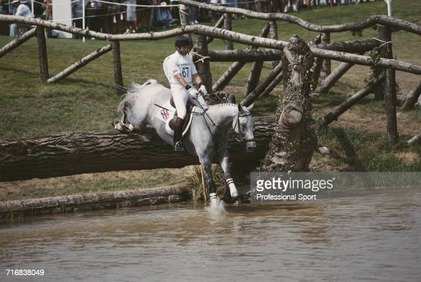 View of Scottish equestrian Ian Stark of the Great Britain team riding Murphy Himself over a wooden log hazard in to water during competition in the...