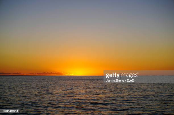 View Of Sea Against Clear Sky During Sunset