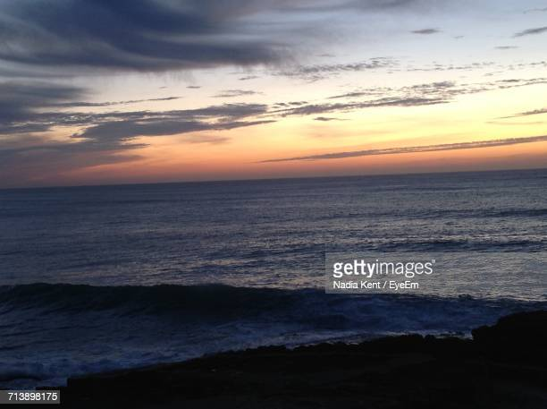View Of Sea Against Cloudy Sky During Sunset