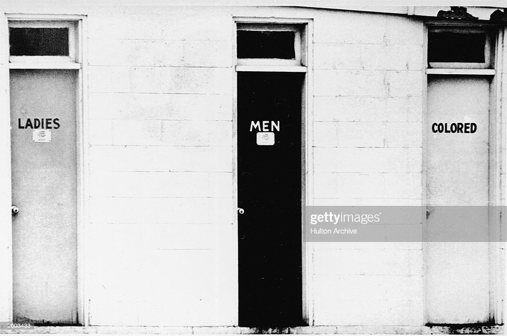 View of segregated public restrooms labeled 'ladies' 'men' and 'colored' circa 1960