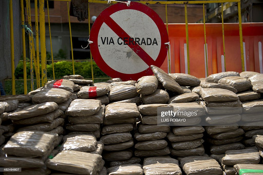 View of seized marijuana packages displayed to be shown to the press, on November 29, 2013, in Cali, department of Valle del Cauca, Colombia. Authorities reported the seizure of 3.7 tons of marijuana inside a truck coming from the Cauca Department, that was intercepted in the rural zone of the municipality of Candelaria. AFP PHOTO/Luis ROBAYO