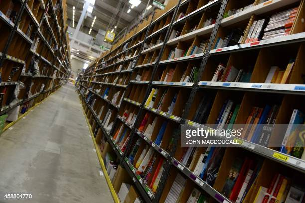 View of shelves where products are stored before distribution at US online retail giant Amazon's Brieselang logistics center west of Berlin on...