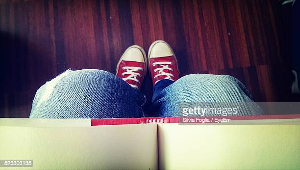 View Of Shoes And Book