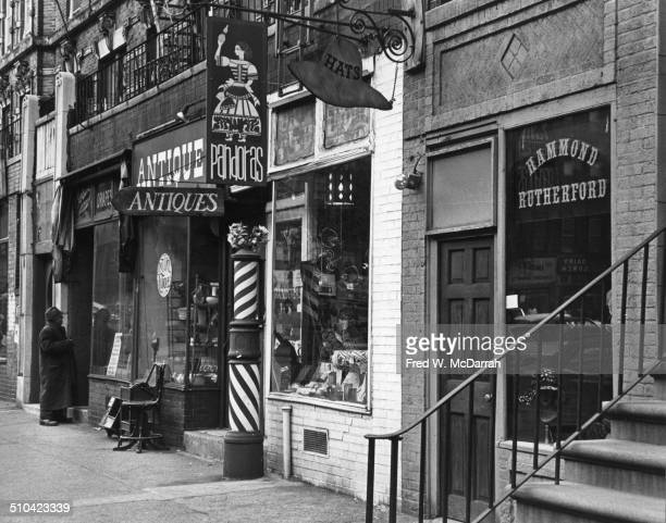 View of shops near the intersection of a St Marks Place and 2nd Avenue New York New York January 16 1966 The view shows the southeast corner of the...