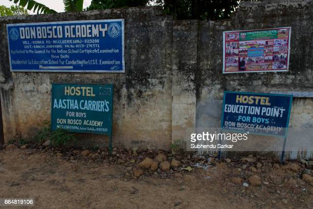 MCCLUSKIEGUNJ RANCHI JHARKHAND INDIA A view of signboards advertising for different hostels for students at McCluskiegunj McCluskiegunj is a town...